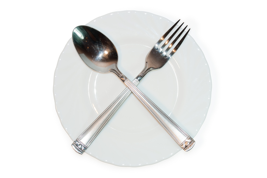 Fork And Spoon Crossed On Plate