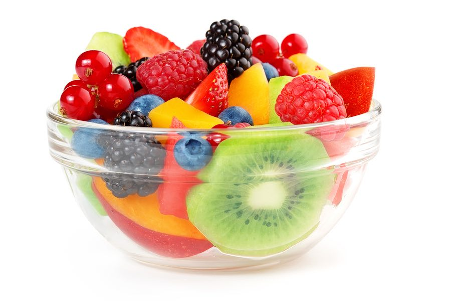 bowl of fruit salad isolated on white background